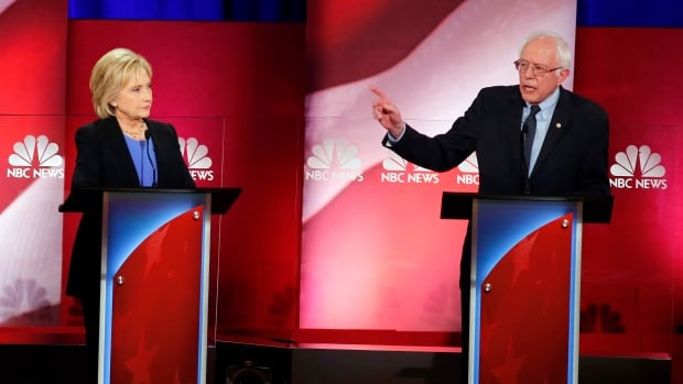 U.S. Democratic presidential candidate Bernie Sanders gestures towards rival Hillary Clinton during the NBC-YouTube debate in Charleston, S.C., on Sunday night.