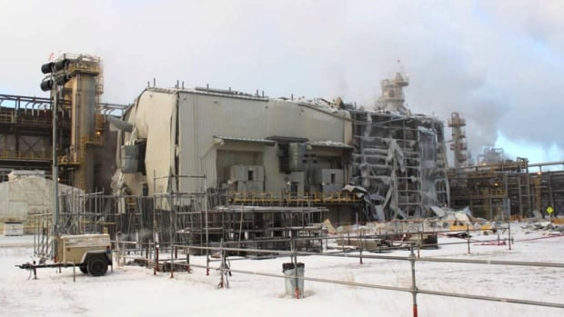 The view of the gas compression building in the hydrocracker unit after an explosion Friday, which killed one worker and critically injured a second.