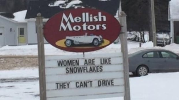 A photo posted to Facebook shows the sign at Mellish Motors that read 'Women are like snowflakes. They can't drive.'