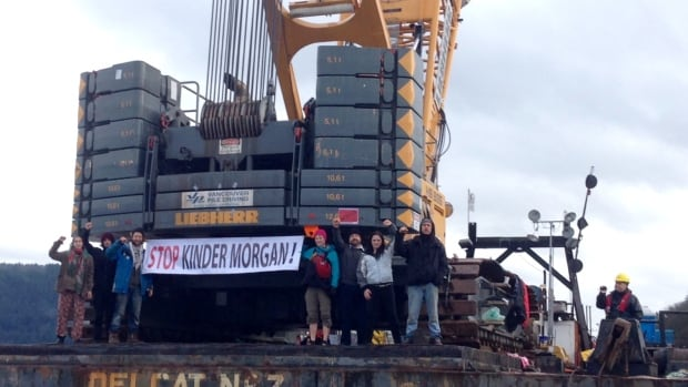 Burnaby RCMP arrested seven protesters who had boarded a barge conducting test drilling for the proposed Kinder Morgan pipeline.
