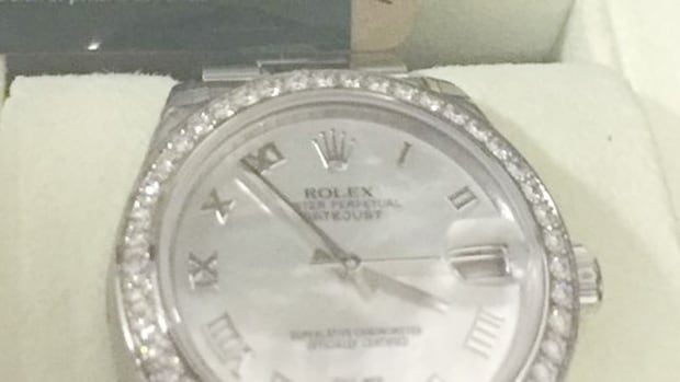 Toronto police are searching for two suspects accused of stealing a Rolex watch valued at $19,600.