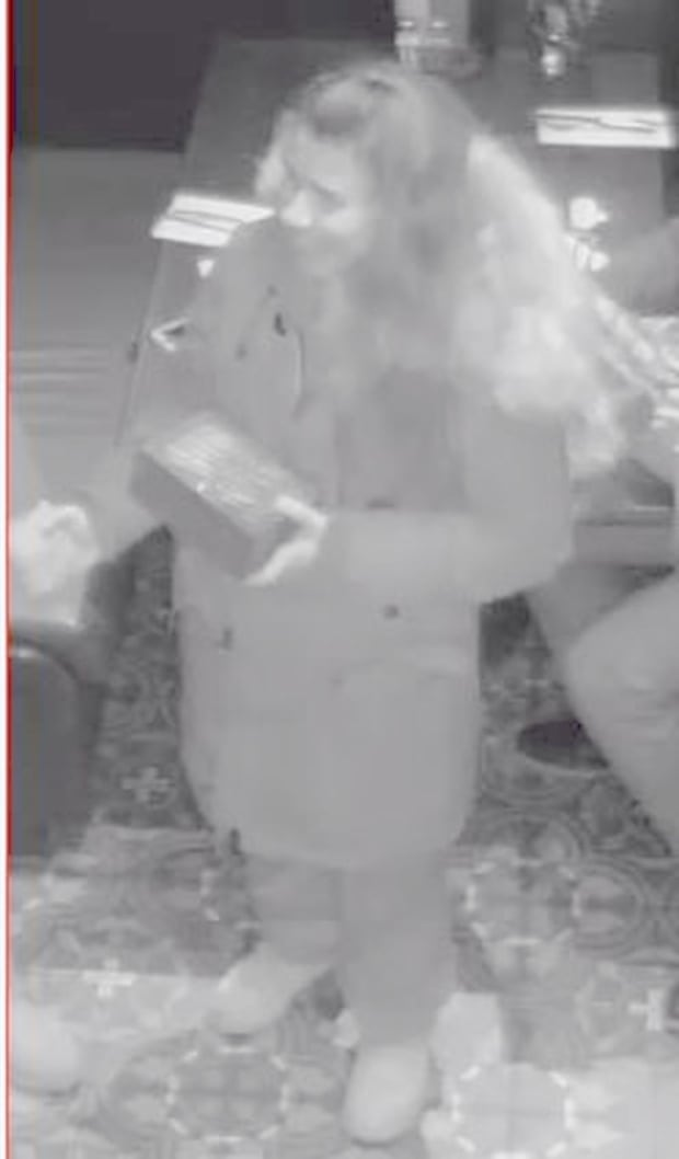 woman suspect Rolex watch