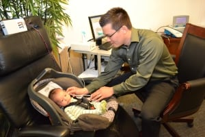 audiologist performing a newborn hearing screening