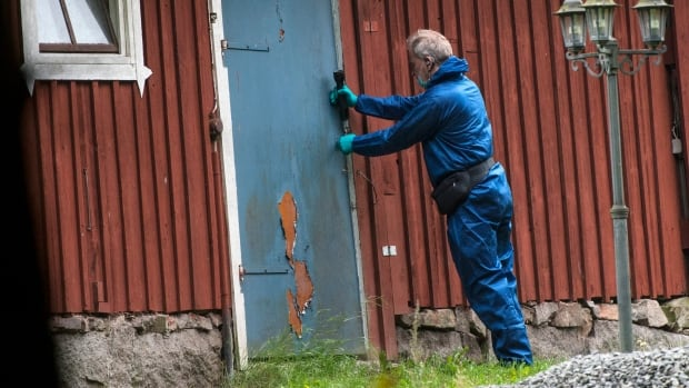 A police forensic officer works at a property outside Knislinge in southern Sweden, Tuesday, Sept. 22, 2015. Prosecutors in Sweden say a doctor drugged a woman with strawberries laced with sedatives, then locked her in a soundproof bunker where he intended to keep her for years.