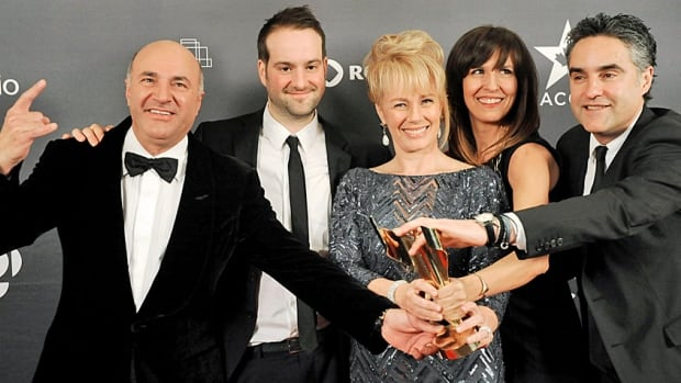 From left, Dragon's Denizens Kevin O'Leary, Mike Armitage, Arlene Dickinson, Lisa Gabrielle and Bruce Croxon pose with their 2013 award for best reality series at the Canadian Screen Awards.