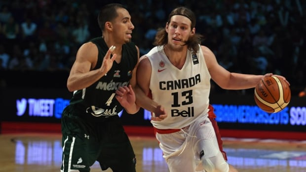 Kelly Olynyk, right, and Canada's men's basketball team defeated Mexico in the bronze medal match at the FIFA Americas Tournament but needed a top-2 finish to get into the Olympics. They'll have one more chance to qualify in July.
