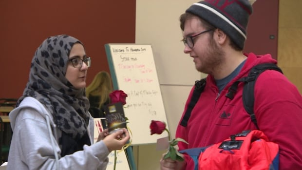 Students at the University of Regina handed out flowers for Islam Awareness Week on Jan. 19, 2016.