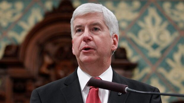 Michigan Gov. Rick Snyder delivers his State of the State address to a joint session of the House and Senate, Tuesday in Lansing, Mich., where he promised transparency as the state deals with a water crisis in Flint.