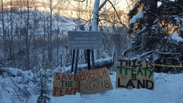 Protesters at the Site C dam project in northern B.C. have been posting signs like these around the worksite.
