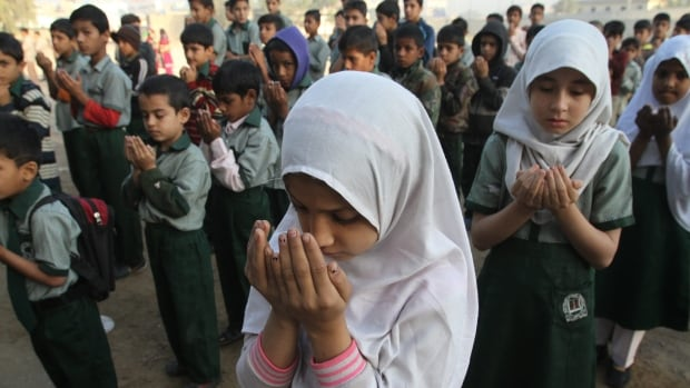 Pakistani students pray for the victims of the Bacha Khan University, at a local school in Karachi. Pakistan observed a day of mourning Thursday after a deadly attack by Islamic militants who stormed a northwestern university the day before.