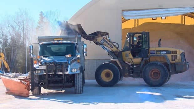 Road salt is loaded onto a truck at the Town of Quispamsis public works yard.