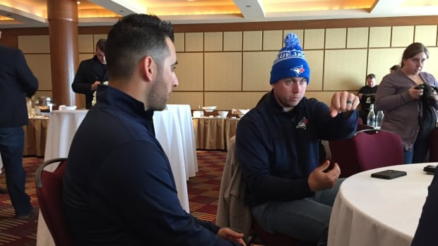 Toronto Blue Jays Marco Estrada, left, and Justin Smoak, right, share stories while on the Ottawa stop of their winter tour.