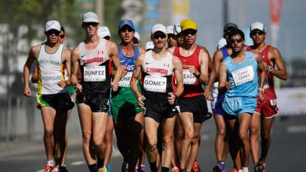 Canada's Inaki Gomez, centre, is one of two track and field athletes, who signed their names to a statement, backing the anti-doping fight and urging officials to implement reforms.