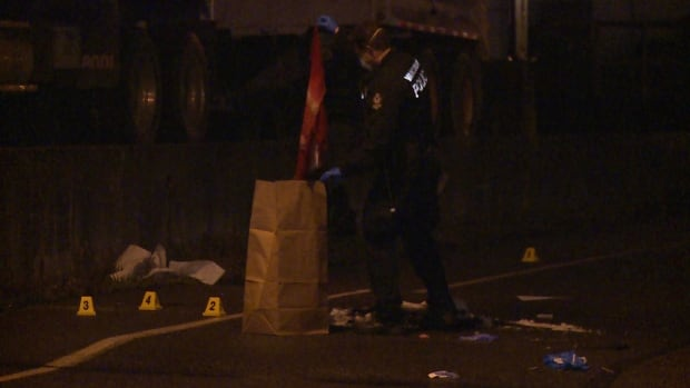 A forensics investigator with the Vancouver Police Department puts a piece of blood-soaked clothing into an evidence bag, following a stabbing Friday night.