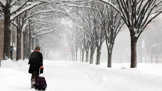 A mammoth snowstorm is underway, leading to flight cancellations and delays.
