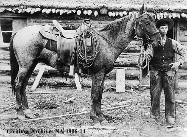 Cowboy with his horse, 1890
