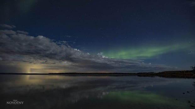 The northern lights on Willow Lake, the base for Northern Lights Tours.