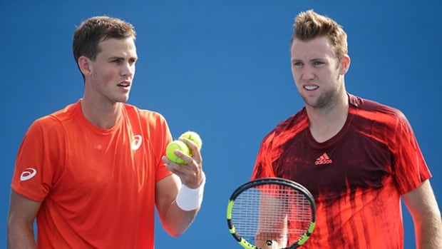 Vasek Pospisil, left, and Jack Sock have advanced to the fourth round of the doubles competition at the Australian Open in Melbourne.