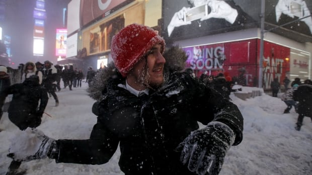 Dozens of people took part in an impromptu snowball fight in Times Square in Manhattan on Saturday.