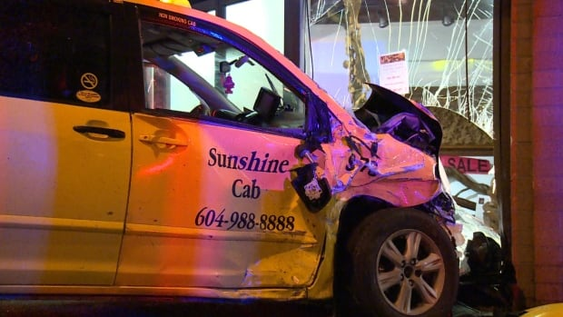 A taxi smashed through the window of a Vancouver gallery and knocked some of the artwork to the ground, following a collision with an SUV Sunday morning.