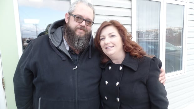 Jeff Bourne, Executive Director of the U-Turn Addictions Drop-In Centre, and Tammy Bourne, the centre's volunteer co-ordinator, outside the centre's main entrance in Carbonear at the beginning of a long day.