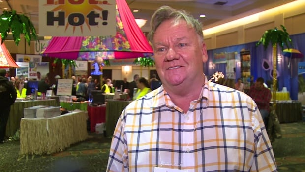 Blair Jerrett of LeGrow's Travel said that he was surprised to see more people at his company's travel show this year than last.