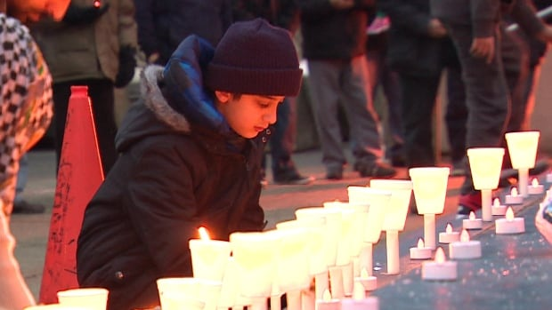 About 60 people from Calgary's Muslim community took to the streets Saturday to honour those lost in a recent attack on a university in northwest Pakistan.