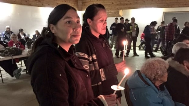 Hundreds gathered at La Loche Community Hall for candle vigil and prayer gathering on Sunday night.