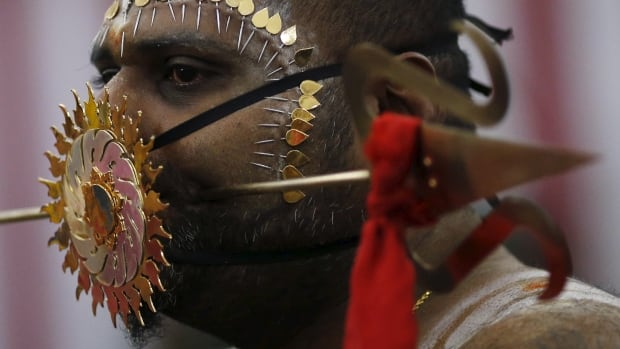 Hindu devotees around the world celebrate the Thaipusam festival with ceremonial piercings like this man's, in Singapore, on Jan. 25, 2016.