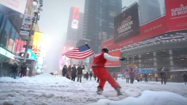 Casey Neistat snowboards through the streets of New York City.