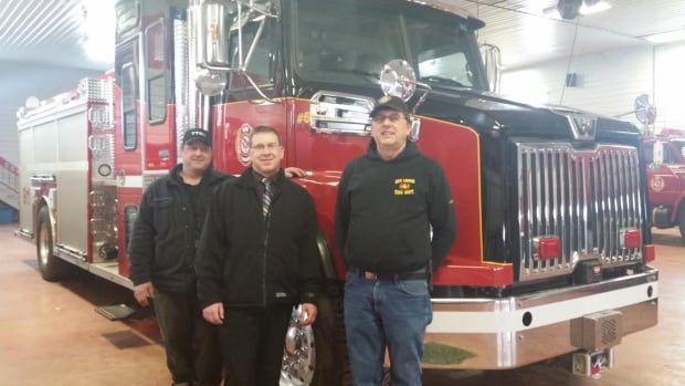 New London volunteer firefighters Scott Cole, John MacIsaac and Allen Cole proudly show off the company's new fire truck.