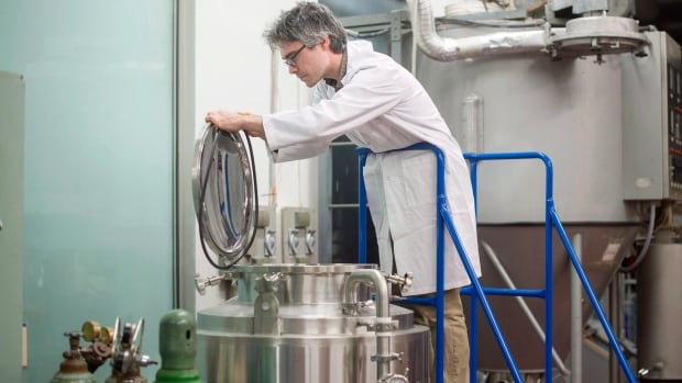 Prof. Andrew MacIntosh, a member of the Canadian Institute of Fermentation Technology at Dalhousie University, works in his lab at the Halifax school.