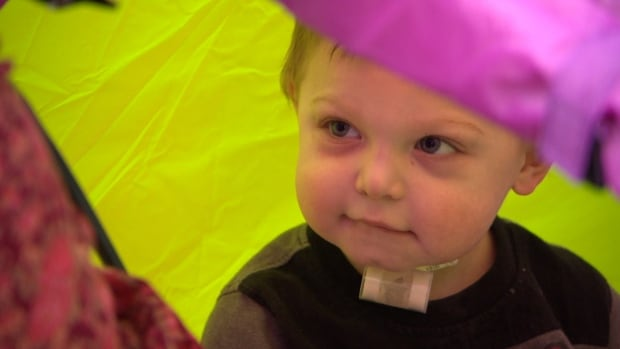 Deagan Clavette peeks out from a play tent. Nearly two years old, he was born to a family from Hay River, N.W.T., but he has called the Pediatric Medical Unit at the Stollery Children's Hospital in Edmonton home for most of his short life.