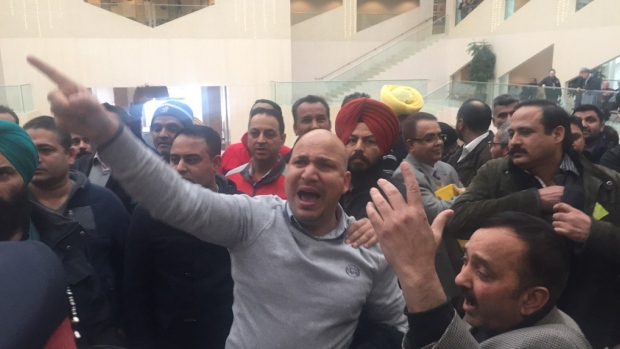 """We want to be let in,"" demanded cab drivers who were ejected from Edmonton city council chambers after a protest Tuesday."