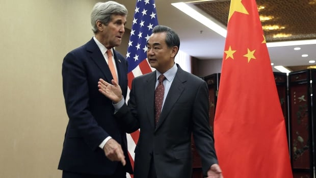 U.S. Secretary of State John Kerry meets with Chinese Foreign Minister Wang Yi before their bilateral meeting at the Ministry of Foreign Affairs in Beijing on Wednesday.