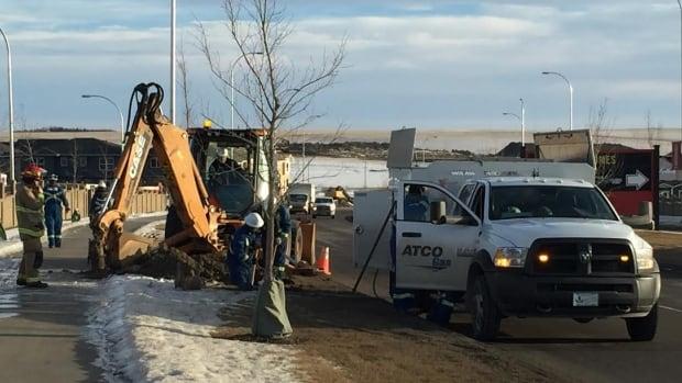 Crews work to shut down a gas line that was ruptured on Wednesday in northwest Calgary.