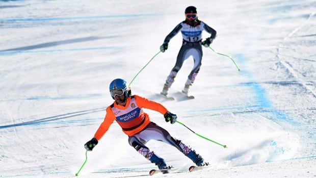 Guide BJ Marcoux, front, and brother Mac Marcoux, back, seen here competing at the 2015 world championships, claimed a World Cup gold medal in the visually impaired category Wednesday in Tignes, France.