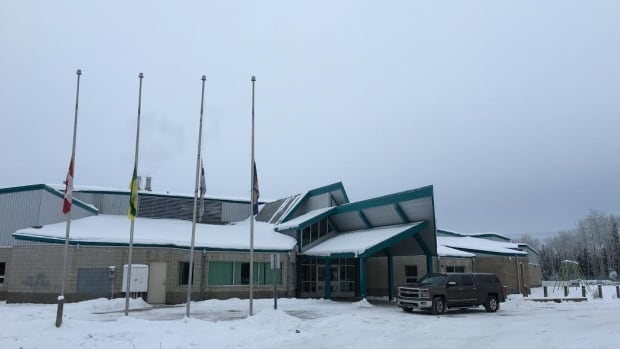 Flags fly at half-mast at the Clearwater River School on the Clearwater River Dene Nation, Sask.