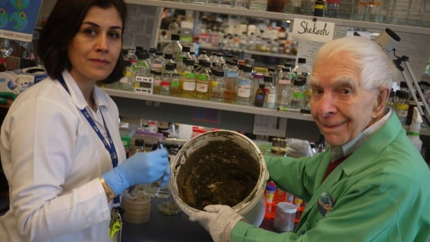 UBC researchers Julian Davies and Shekooh Behroozian in the laboratory with a bucket of Kisameet clay.