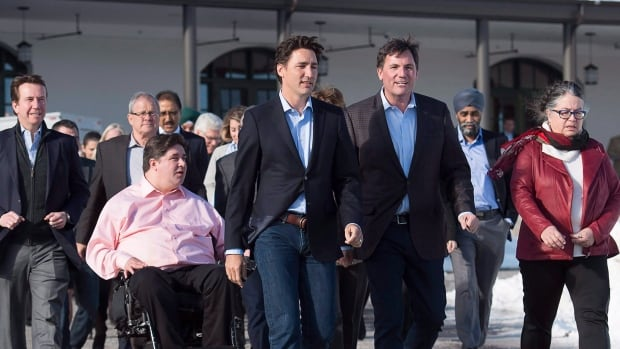 Government House Leader Dominic LeBlanc, centre right, seen here with Prime Minister Justin Trudeau and the rest of his cabinet at its retreat in New Brunswick last week, has been asked to lead the charge towards reforming how the House of Commons works.