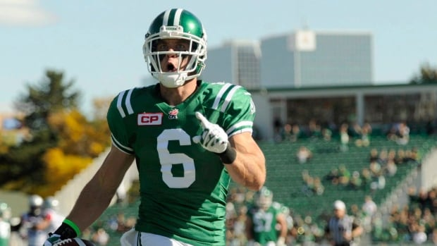 Saskatchewan Roughriders' wide receiver Rob Bagg celebrates a touchdown during first half CFL action against the Montreal Alouettes in Regina on Sunday, Sept. 27, 2015.  The team has re-signed him to a new contract that will see him playing with the Green and White through 2018.