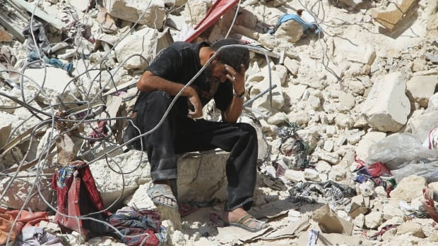 A man reacts amidst rubble after what activists said was an airstrike by forces loyal to Syrian President Bashar al-Assad in Aleppo's rebel-controlled Al-Mashad neighbourhood on Sept. 17.