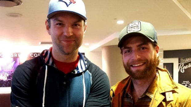 John Scott, left, shown here with the Capitals' Braden Holtby, arrived in Nashville Thursday for the NHL All-Star game after writing a piece for The Players Tribune describing the journey he's been on since being selected.