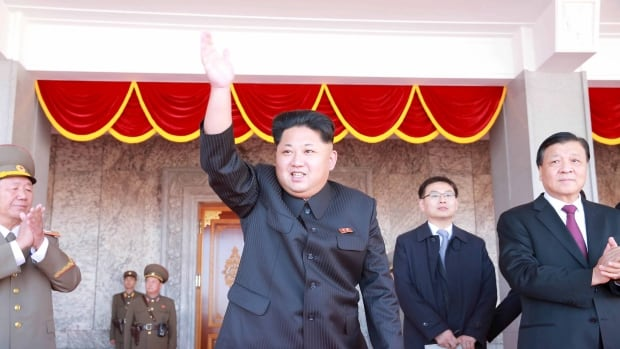 North Korean leader Kim Jong-un waves in this undated photo released by North Korea's Korean Central News Agency. Kim's regime is reportedly making preparations to launch a rocket or a missile.