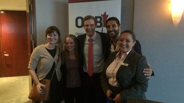 A photo from Premier Brian Gallant's Facebook shows him with guests at the 'alumni event' in Montreal.