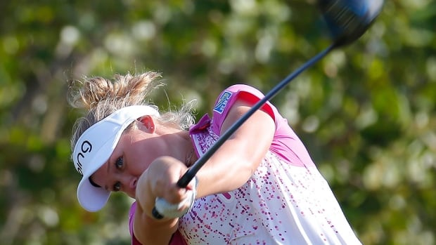 Canada's Brooke Henderson tees off at the fourth hole during first-round action of the Pure Silk Bahamas LPGA Classic in Paradise Island on Thursday. The 17-year-old from Smiths Falls, Ont., shot a 2-under 71 and sits in a tie for 18th place, three shots off the pace. Fellow Canadians Maude-Aimee Leblanc and Alena Sharp are tied for 45th at even-par.