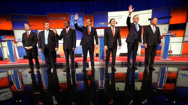 Republican U.S. presidential candidates, from left to right, U.S. Senator Rand Paul, Gov. Chris Christie, Dr. Ben Carson, Senator Ted Cruz, Senator Marco Rubio, former governor Jeb Bush and Governor John Kasich pose together onstage at the start of the debate held by Fox News in Des Moines, Iowa.