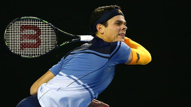 Canada's Milos Raonic plays a shot to Andy Murray during their Australian Open semifinal at Melbourne Park on Friday. Murray defeated Raonic in a marathon match.