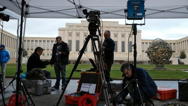 A television crew sets up ahead of the start of Syrian talks in front of the United Nations European headquarters in Geneva on Friday.