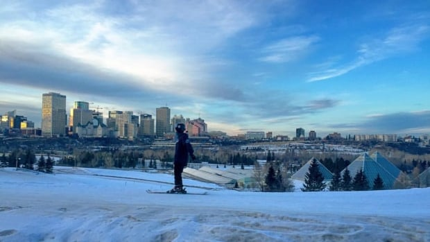 This skier tries to catch some powder at the Edmonton Ski Club .
